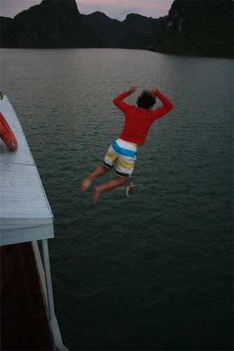 Me… less gracefully jumping off of our boat.