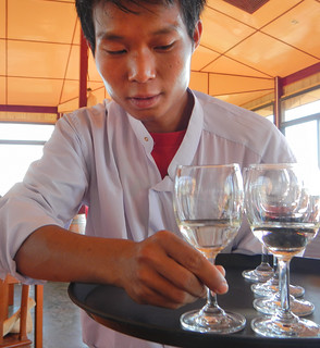 Server at the Inle Lake Winery in the Town of Nyaung Shwe, Myanmar