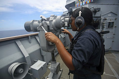 A watchstander aboard USS Ashland (LSD 48) looks for other vessels as the ship transits the South China Sea. (U.S. Marine Corps/Lance Cpl. Carl King)