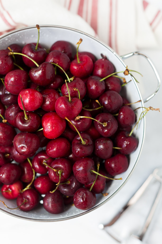 bing cherries in colander for rum cherry ice cream