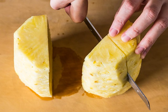 Slicing pineapple