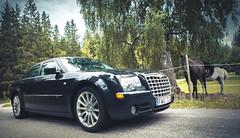supercar(0.0), sports car(0.0), automobile(1.0), executive car(1.0), vehicle(1.0), automotive design(1.0), chrysler 300(1.0), chrysler(1.0), sedan(1.0), land vehicle(1.0), luxury vehicle(1.0),