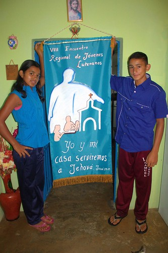 Karelis and Pedro Santana with the banner they took to the youth encounter.