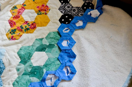 Step 1: Attach back-side hexagons, with right sides facing, to front of quilt one-by-one