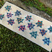 Dancing Stars Table Runner Quilted by Marci Girl Designs