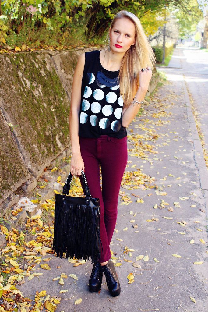 Edgy fall outfit that consists of moon eclipse graphic top/vest, burgundy color pants, lita like heels (from Ebay), fringe tassel bag and sheepskin feather necklace.