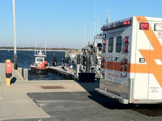 Crewmembers from Coast Guard Station Barnegat Light, N.J., medevac a head injury victim, Friday, Oct. 25, 2013. The 47-year-old man was a passenger aboard a 21-foot center console boat that ran aground in Oyster Creek, in the Barnegat Bay. U.S. Coast Guard photo