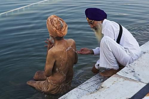 Sikh men taking holly bath in Golden Temple, Amritsar, North India