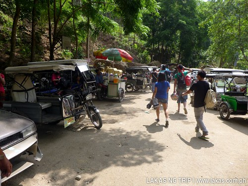 Tricycles waiting at the entrance of Daranak Falls