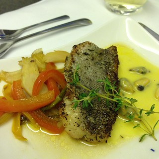 Sauteed seabass with garlic flavored vegetables and saffron clam sauce