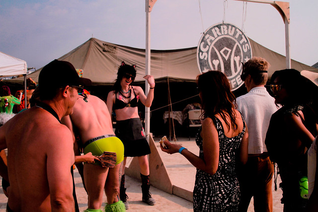 Burning Man works on a barter/exchange system. Here you see people trading a spank for a delicious cup of coffee.