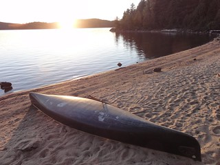 Sunset, Booth Lake plus canoe: Note the odd white patches on the canoe's hull. What are they?