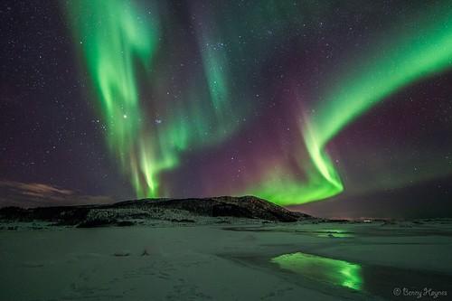 Aurora dances over hill in winter 2013 at Roksøy, Sortland, Norway.