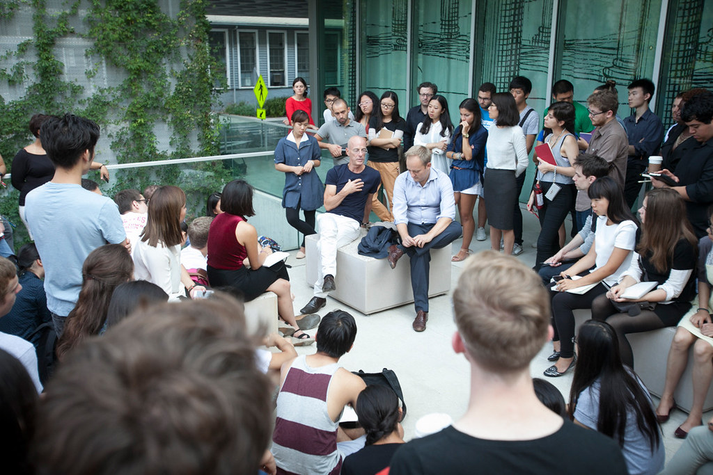 Herzog and Pajkic in conversation with students on Milstein Hall's West Plaza.