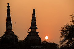 double stupas with sunset moment