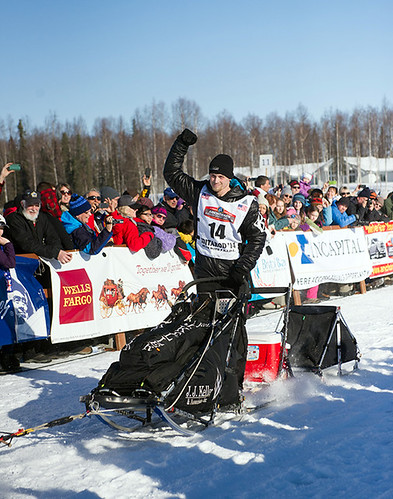 Hand held high by musher Dallas Seavey at the start of the 2014 Iditarod.