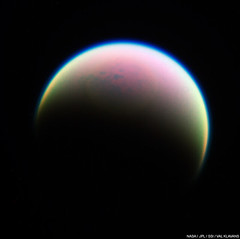 Titan's Northern Wetlands and Atmosphere