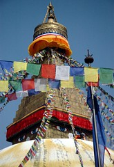 Adding Tibetan Buddhist prayer flags to Bodha stupa, the wish fulfilling stupa, Kathmandu, Nepal