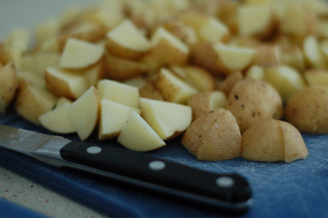 Cutting up potatoes for the vichyssoise (potato leek) soup by Eve Fox, the Garden of Eating, copyright 2015