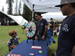 Maui Electric at the Lanai Pineapple Festival - July 2, 2016: Keiki checking out the prize wheel