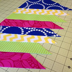 Cutting out pennants for my @sewmamasew Giveaway Day winner!