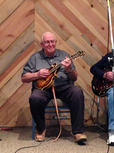 Pop playing his mandolin