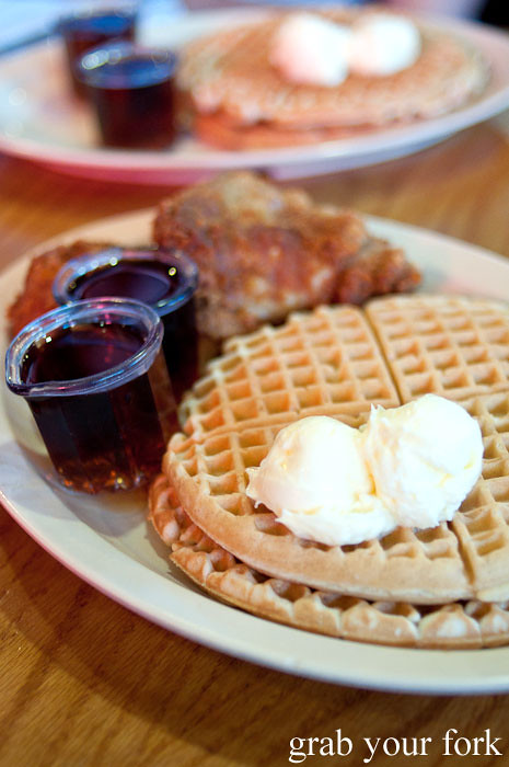 fried chicken waffles and maple syrup at roscoes house of chicken and waffles in la los angeles