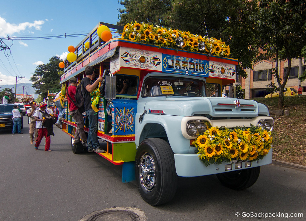 A TV crew jumps aboard the Jardin chiva as it begins driving the parade route
