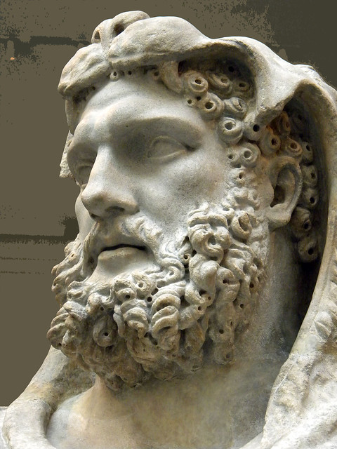 The marble statue of a bearded hercules