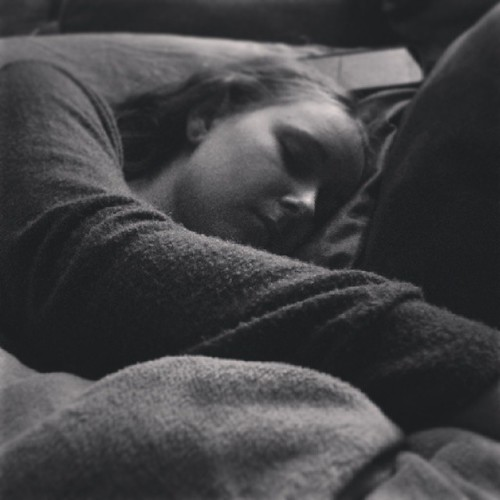 My favorite thing to take pictures of. My daughter asleep next to me. by Random and Odd