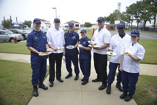 Coast Guard members that participated in a cooking competition at Coast Guard Station Little Creek in Virginia Beach, Va., stand for a group photo following the judging, Monday, Oct. 28, 2013. Participating units include Coast Guard Stations Little Creek and Cape Charles and Coast Guard Cutters Albacore, Beluga and Sea Horse. U.S. Coast Guard photo by Petty Officer 1st Class Brandyn Hill
