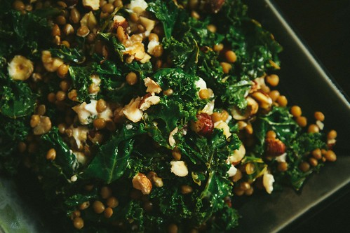 Warm salad of lentils and kale with goats cheese and hazelnuts