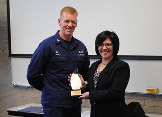Capt. Brian Roche, commander of Coast Guard Sector Buffalo, N.Y., recognizes Debra Stancliff, the unit's education services officer, as the Coast Guard's Full-Time Education Services Officer of the Year during a ceremony at the sector, Feb. 20, 2014.  Stancliff, who officially received the award at an education symposium earlier in the month, demonstrated exceptional performance in the areas of educational leadership, innovative problem solving, and customer outreach.  U.S. Coast Guard photo courtesy of Coast Guard Sector Buffalo