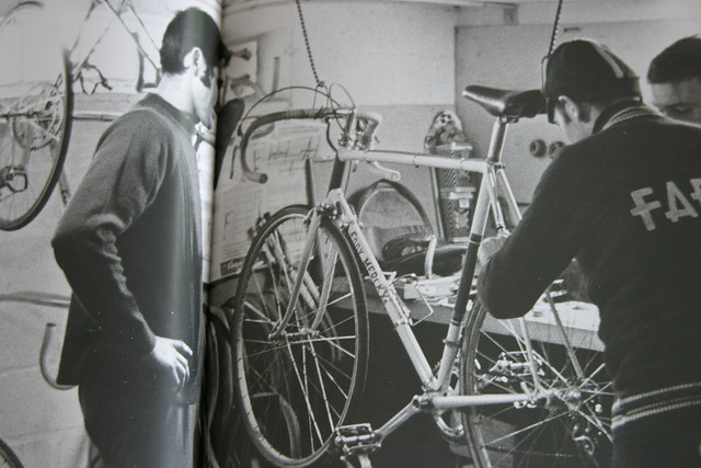 Eddy working on his bike, with Roger de Vlaeminck watching