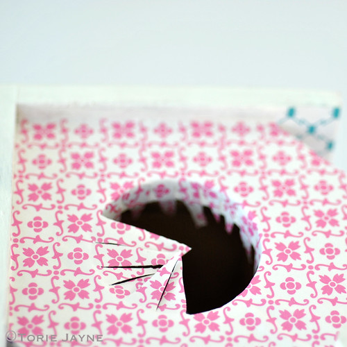 Push paper in to hole
