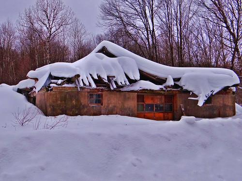 snow barn damage