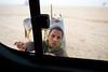 The bus chasing beggar, Luxor, Egypt