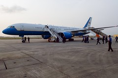 U.S. Secretary of State John Kerry walks to his airplane at the airport in Lagos, Nigeria, after he met with Nigerian President Goodluck Jonathan and his re-election challenger, retired Major-General Muhammadu Buhari, on January 25, 2015, for conversations urging both candidates to accept the results of their upcoming general-election vote. [State Department Photo/Public Domain]