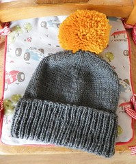 Knitted pom-pom hat and cowl for barney