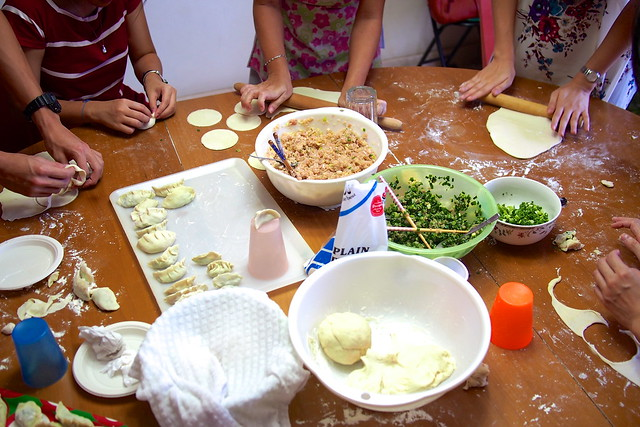 making dumplings on the second day of Chinese New Year, Singapore