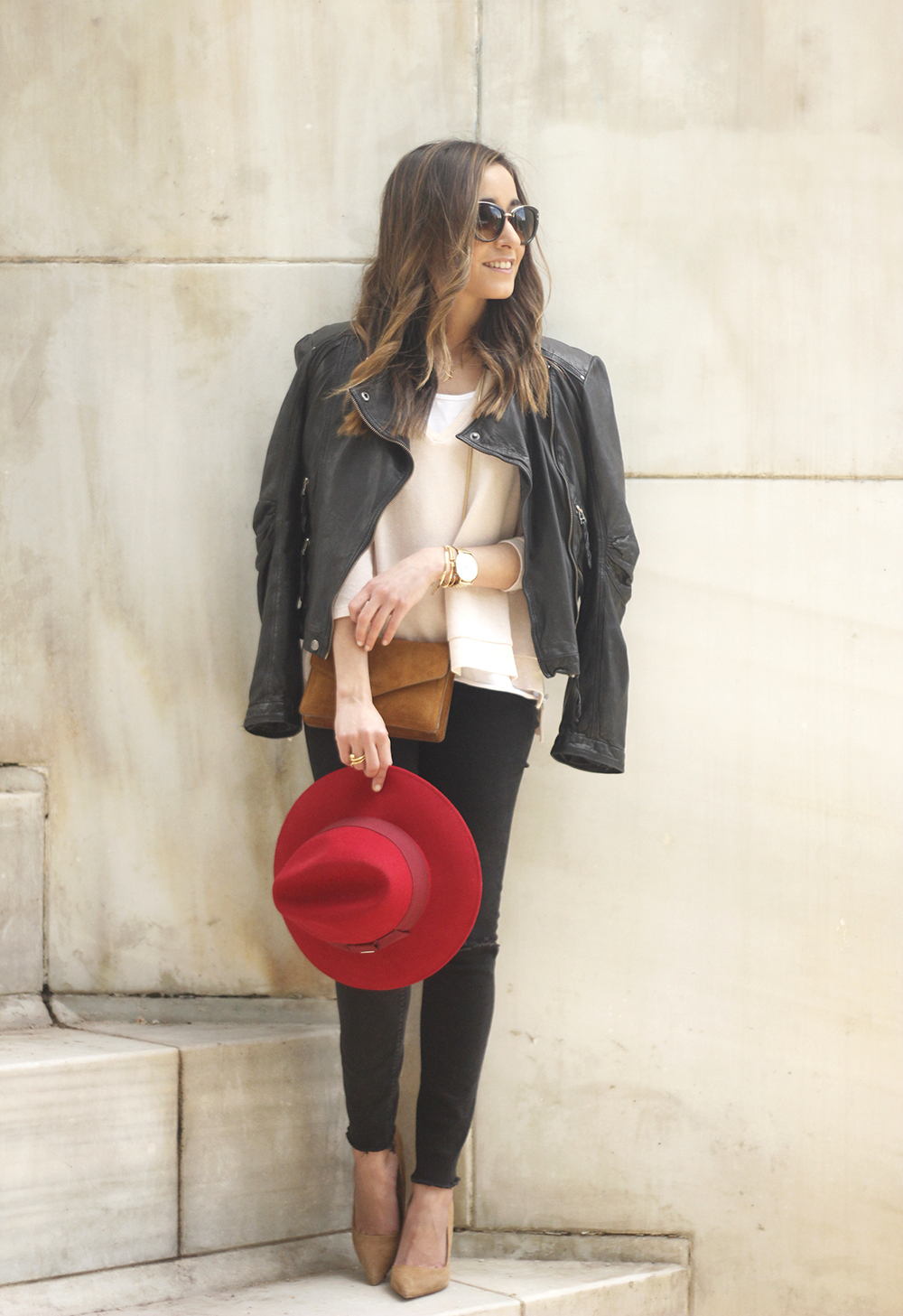 black biker jacket ripped jeans red hat camel bag outfit fashion style spring20
