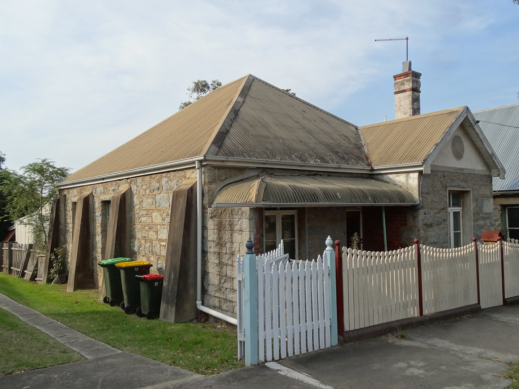 Moruya. Established 1850. Known as granite town. A grantie block cottage with side buttreses in the town.
