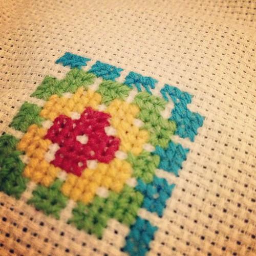 Cross stitching granny squares.