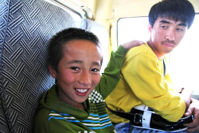 Smiling boy in the bus, Kumul (Hami) ハミ、バス車内の少年