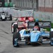 Simon Pagenaud leads the field into Turn 4