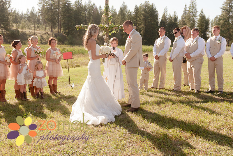 Bride and groom say their vows at their outdoor wedding in rural Washington.