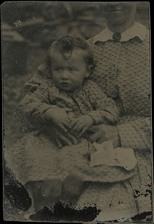 Tiny Tintype of a Baby With a Hidden Mother in Matching Dresses