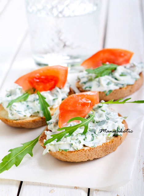 Bruschetta with cheese and rocket spread