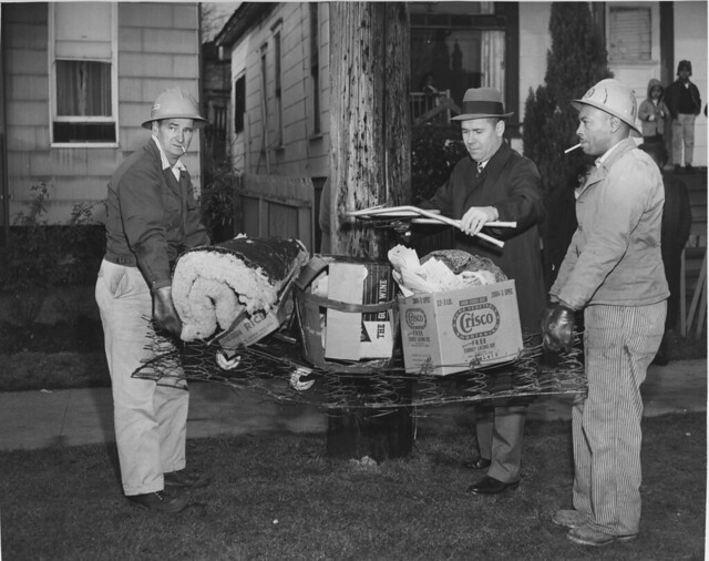 Hauling the garbage away after a clean up in Seattle - Seattle Municipal Archives.