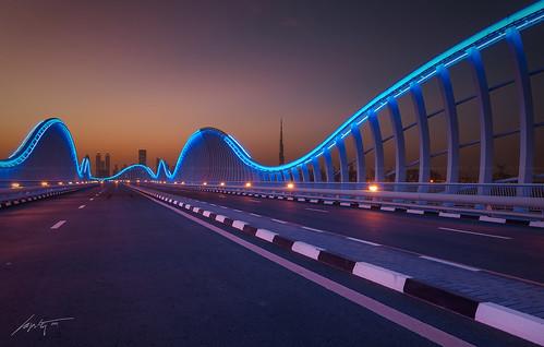 road bridge light sunset urban night nikon neon dubai top uae tokina khalifa hdr blending meydan d300s mydubai